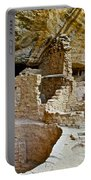 One End Of Spruce Tree House On Chapin Mesa In Mesa Verde National Park-colorado Portable Battery Charger