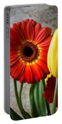 Orange Daisy With Tulips Portable Battery Charger