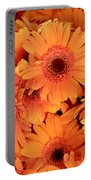 Orange Gerbera Daisies Portable Battery Charger