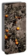Orange Tree On Rustic Background Portable Battery Charger