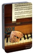 Ornate Mask On Piano Keys Portable Battery Charger