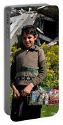 Pakistani Boy In Front Of Hotel Ruins In Swat Valley Portable Battery Charger
