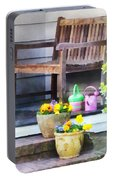 Pansies And Watering Cans On Steps Portable Battery Charger