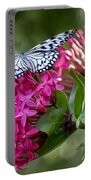 Paper Kite On Fluid Blossoms Portable Battery Charger