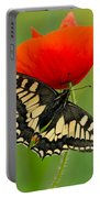 Papilio Machaon Butterfly Sitting On A Red Poppy Portable Battery Charger