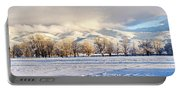 Pasture Land Covered In Snow With Taos Portable Battery Charger
