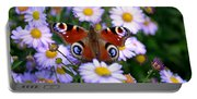 Peacock Butterfly Perched On The Daisies Portable Battery Charger