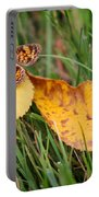 Pearl Crescent Butterfly On Yellow Leaf Portable Battery Charger
