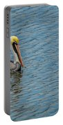 Pelican Drifting On Rippled Water Portable Battery Charger