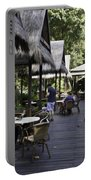 People At The Breakfast Table In A Hotel In Sentosa In Singapore Portable Battery Charger