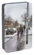 People On Bicycles In Winter Portable Battery Charger