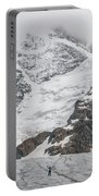 Person Cheering On A Glacier Portable Battery Charger