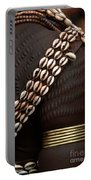 Person Showing Cowry Shell Detail Portable Battery Charger