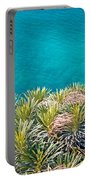Pine Tree Branches With Turquoise Sea Background Portable Battery Charger