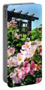 Pink Roses Near Trellis Portable Battery Charger