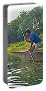 Poling A Dugout Canoe In The Rapti River In Chitwan National Park-nepal Portable Battery Charger