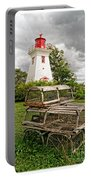 Prince Edward Island Lighthouse With Lobster Traps Portable Battery Charger by Edward Fielding