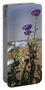Purple And White Flowers In The Sun Portable Battery Charger