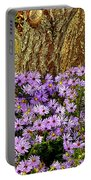 Purple Flowers At Base Of Tree Portable Battery Charger