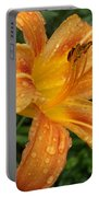 Raindrops On Golden Lily Portable Battery Charger