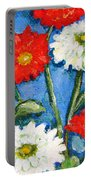 Red And White Flowers With A Blue Sky Portable Battery Charger
