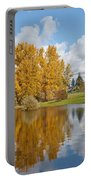 Red Barn And Fall Colors Reflected In A Pond Portable Battery Charger
