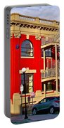 Red Building On Water Street In Saint John's-nl Portable Battery Charger