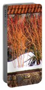 Red Bushes And Rock Wall Portable Battery Charger