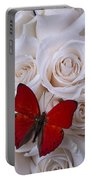 Red Butterfly Among White Roses Portable Battery Charger