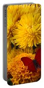 Red Butterfly On African Marigold Portable Battery Charger