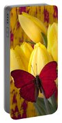 Red Butterfly Resting On Tulips Portable Battery Charger