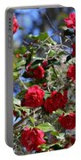 Red Camellias And Blue Sky Portable Battery Charger