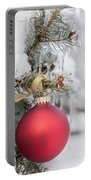 Red Christmas Ornament On Snowy Tree Portable Battery Charger