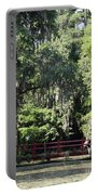 Red Footbridge Over Green Water Portable Battery Charger