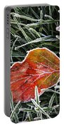 Red Frosty Leaf On Frozen Ground Portable Battery Charger