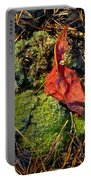 Red Leaf On Moss Portable Battery Charger