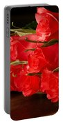 Red Roses On Wood Floor Portable Battery Charger