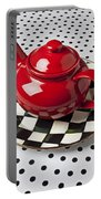 Red Teapot On Checkerboard Plate Portable Battery Charger