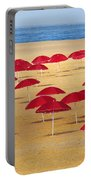 Red Umbrellas Portable Battery Charger by Carlos Caetano
