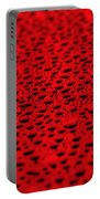 Red Water Drops On Water-repellent Surface Portable Battery Charger