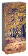 Riding A Bike In Autumn Portable Battery Charger