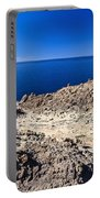 rocky coast in San Pietro island Portable Battery Charger