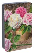 Roses In An Earthenware Vase By A Mossy Portable Battery Charger