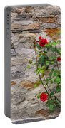 Roses On A Stone Wall Portable Battery Charger