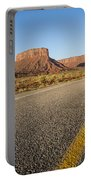 Route 128 Near Castle Valley Portable Battery Charger by Adam Romanowicz