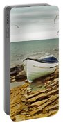 Row Boat On Rocky Shore Portable Battery Charger