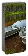 Row Boats Lining A Lake In Mammoth Lakes California Portable Battery Charger