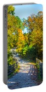 Runner's Path In Autumn Portable Battery Charger
