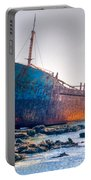 Rusty Old Shipwreck Aground  On Rocky Reef Portable Battery Charger
