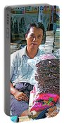 Salesman In The Marketplace In Tachilek-burma Portable Battery Charger
